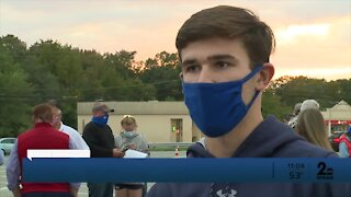 Dozens rally in Anne Arundel County for the return of high school sports