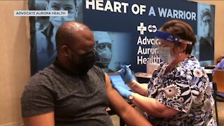 Wisconsin health care workers receive the COVID-19 vaccine