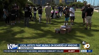 Local artists paint murals on boarded-up windows