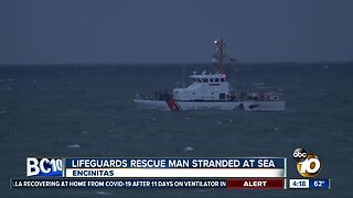 Lifeguards rescue man stranded at sea