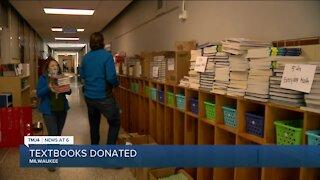 St. Joseph Academy donates books to Rotary Club of Milwaukee