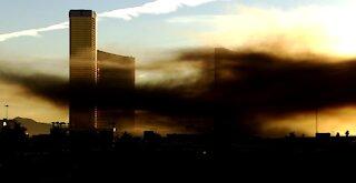 Firefighters extinguish brush fire near I-15, Las Vegas Strip