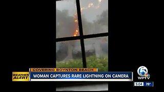 Woman accidentally captures intense lightning video