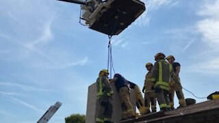 Henderson woman freed by first responders after climbing into chimney