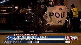 Officer injured after driver hits cruiser Thursday morning