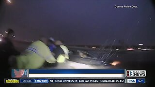 Officers form human chain to rescue family