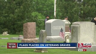 Flags placed on graves of veterans