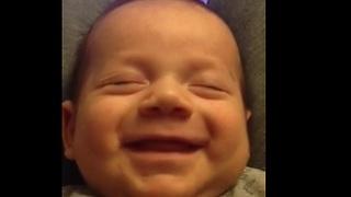 Baby boy preciously laughs in his sleep