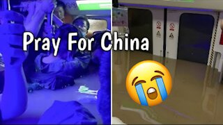 Passengers trapped in flooded subway in China 😔 😭