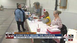 Salvation Army volunteers making Christmas meal kits