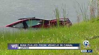 Man pulled from vehicle in canal off I-95