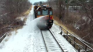 Train almost takes out drone with water canon