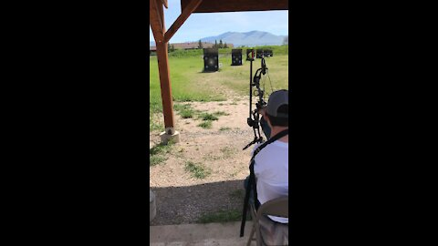 Boy Shoots Compound Bow With Feet