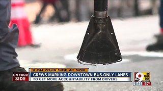 Crews marking Downtown bus-only lanews