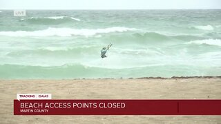 Wind surfers on Stuart Beach as impacts from Isaias are felt