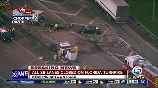 Semi, vehicle crash on Turnpike southbound closes road
