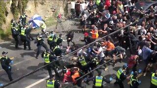 Anti Lockdown Protestors Break Thru Police Line in Australia