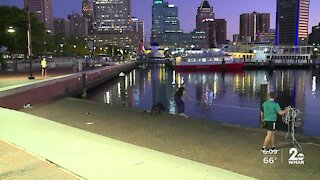 Man falls into the Inner Harbor and saved by joggers passing by