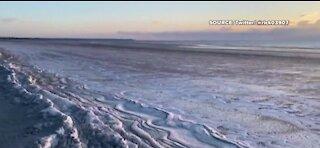 Video shows a frozen beach in Maine
