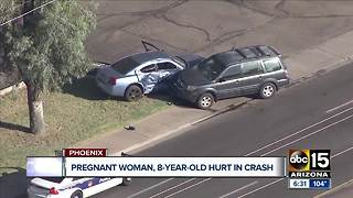 Pregnant woman, child hospitalized after crash near 35th Avenue and Thomas