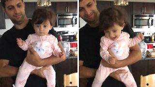 Dancing baby girl adorably does the twist