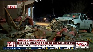 Truck crashes into apartment building during police chase