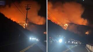 Apocolypic view of hillside during Bond Fire in Orange County