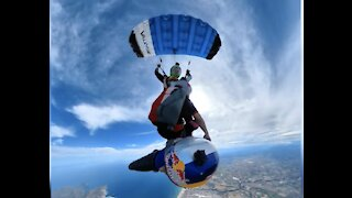 Incredible Stunt Sees Parachutist Drop a Person onto a Wing Suit Glider