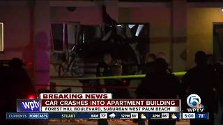 Car crashes into apartment building near Greenacres with family sleeping inside