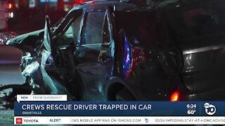 Driver rescued after being trapped in wrecked car