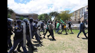 Police escorting the protesters towards the Brackenfell Train station