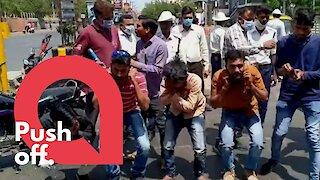 Indian police punish people ignoring coronavirus curfew with squats