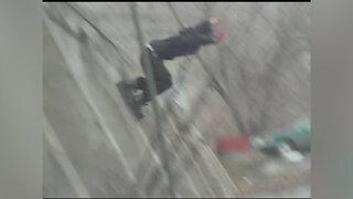 Teenager skating falls off wall