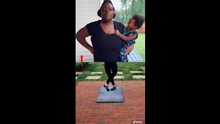 """Mom hilariously """"dances"""" while holding her baby"""