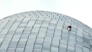 Man arrested after climbing skyscraper in Barcelona
