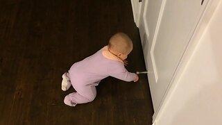 Baby is Mesmerized by Door Stop