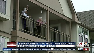Senior Citizens sing from their balconies