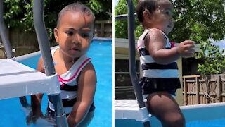 Fearless toddler impressively swims independently in the pool