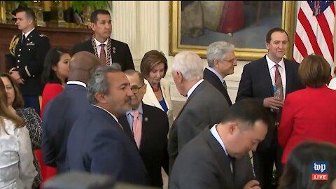 Despite Fining 4 House Members, Pelosi Wears No Mask While Walking Through Crowd