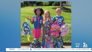 Girl Scouts collecting book bags