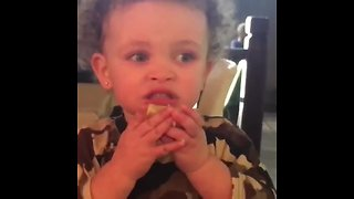 Toddler can't stop eating lemon, gives priceless facial expression
