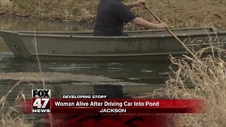 Driver alive after driving into pond in Jackson