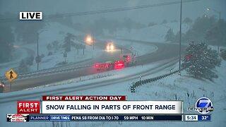 Snow falling around Front Range