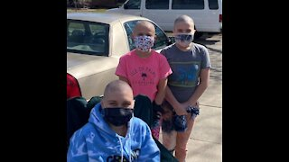 Sisters shave their heads to support brother's girlfriend with cancer