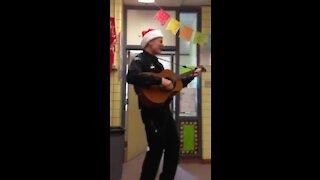Officer Beesley sings Feliz Navidad