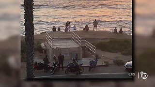 Crowds gather at Sunset Cliffs after some parks reopen