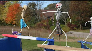 Surf's up at newest Holy Hill Skeleton display