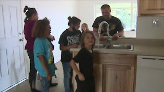 Volunteers finish remodel for Adams County family with 8 special needs kids