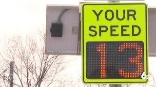 high school seniors help install new speed limit signs