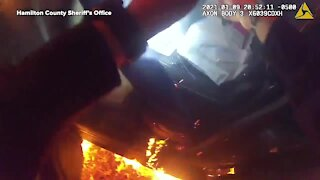 Unconscious woman saved from burning car